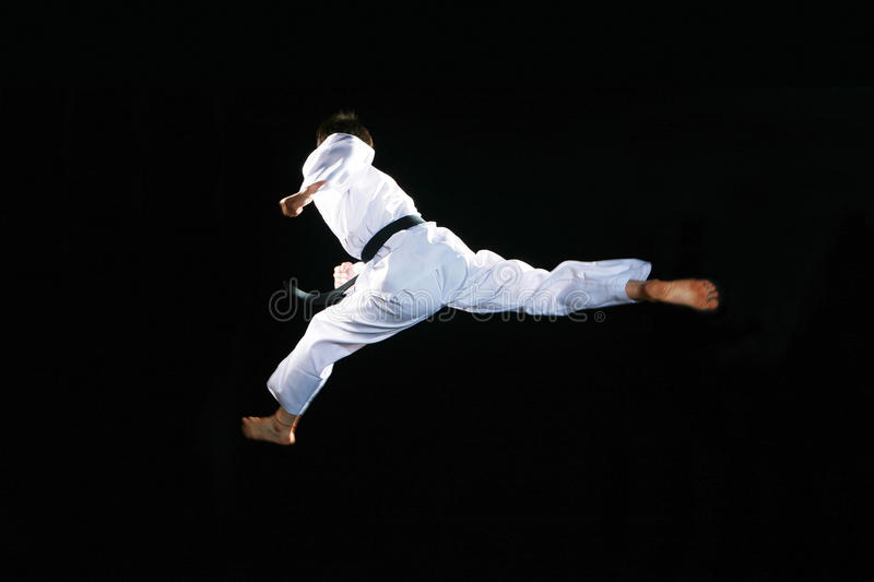 Taekwondo. Asian man playing with taekwondo stock image