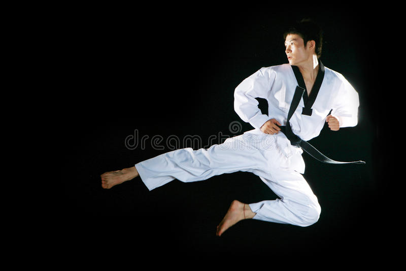 Taekwondo. One asian man is playing with taekwondo stock photos