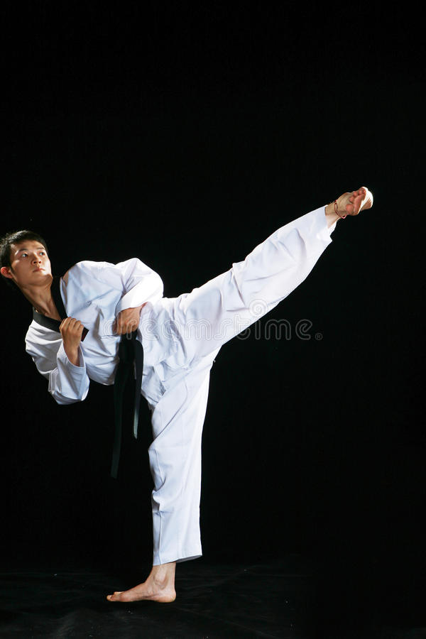 Taekwondo. One asian man is playing with taekwondo stock photo