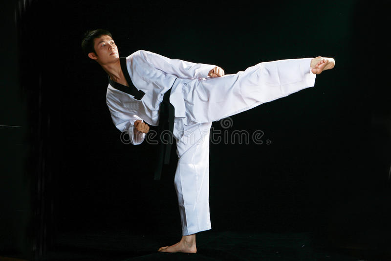 Taekwondo. Asian man playing with taekwondo royalty free stock photos