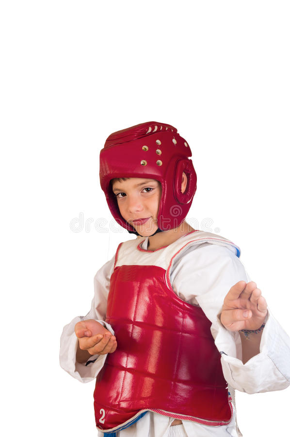 Taekwondo. The boy in sportswear for employment taekwondo on a white background stock photo
