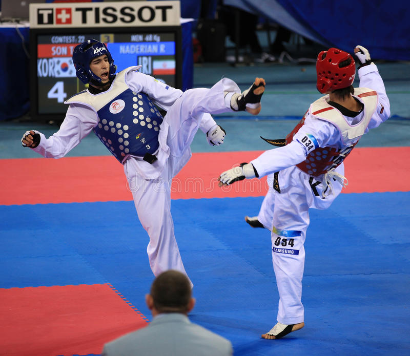 Taekwondo action. BEIJING-SEP 02: Taejin Son of Korea (R) fights against Reza Naderian of Iran (L) during the Taekwondo competitions of the SportAccord Combat royalty free stock photos