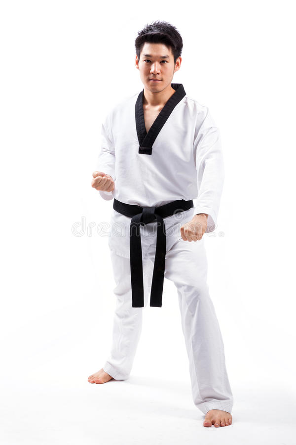 Taekwondo action. By a young man stock photos