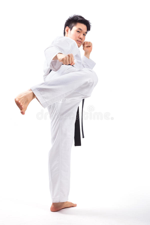 Taekwondo action. By a young man stock photography