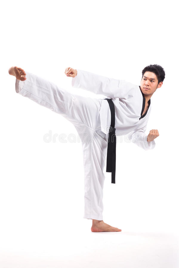 Taekwondo action. By a young man royalty free stock image