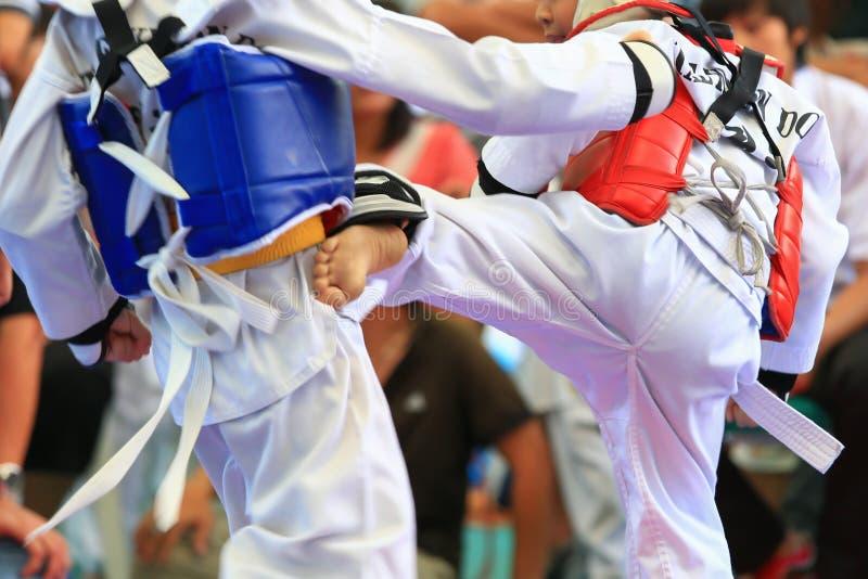 Taekwondo athletes fighting on stage royalty free stock images