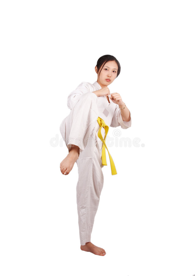 Taekwondo girl. Asian girl doing taekwondo training, isolated on white royalty free stock photo