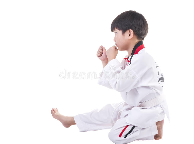 Taekwondo. Little boy in taekwondo suit on a white background stock image