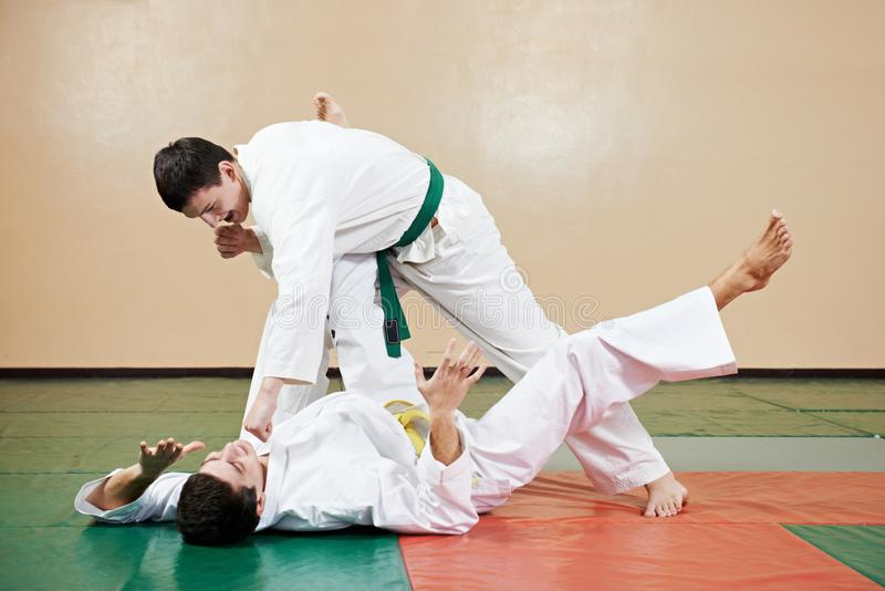 Taekwondo exercises. training throw. Taekwondo martial art. Two young adult people in kimono training throw at gym royalty free stock photo