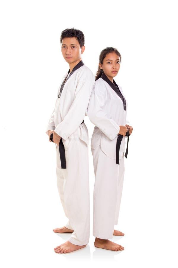 Taekwondo para stoją do tyłu na całej długości zdjęcia royalty free