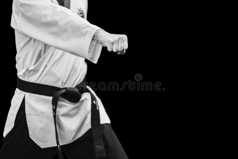 Taekwondo Traditional Korean Male Fighter Punch Fist. On black royalty free stock image