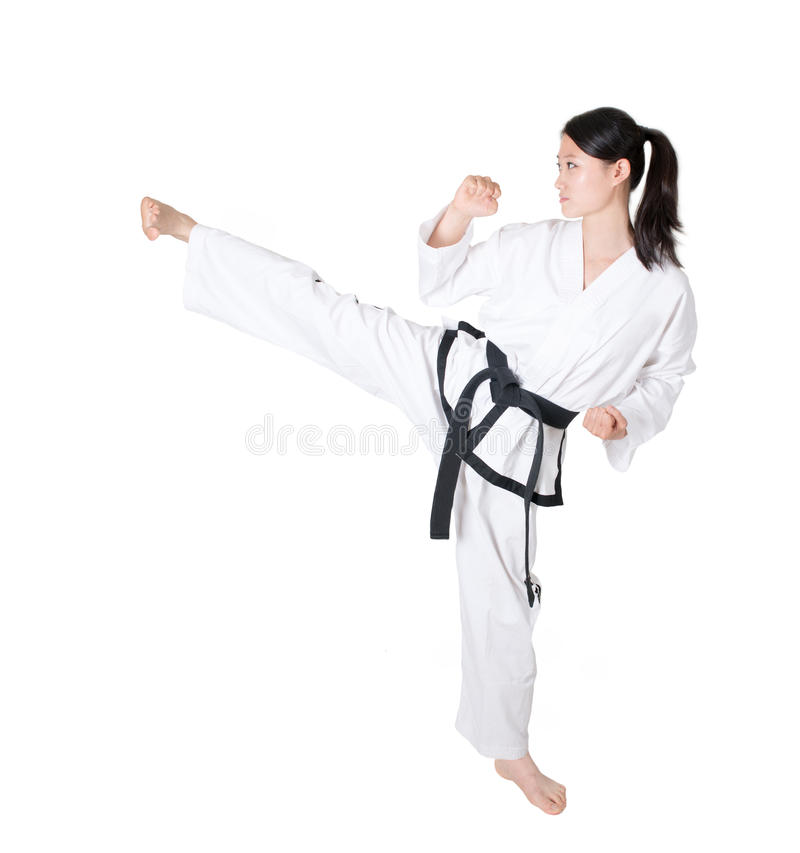 Taekwondo. Woman practicing taekwondo isolated on white background, kicks stock image