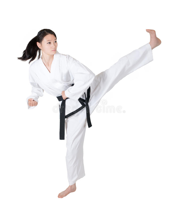 Taekwondo. Woman practicing taekwondo isolated on white background, kicks stock photos