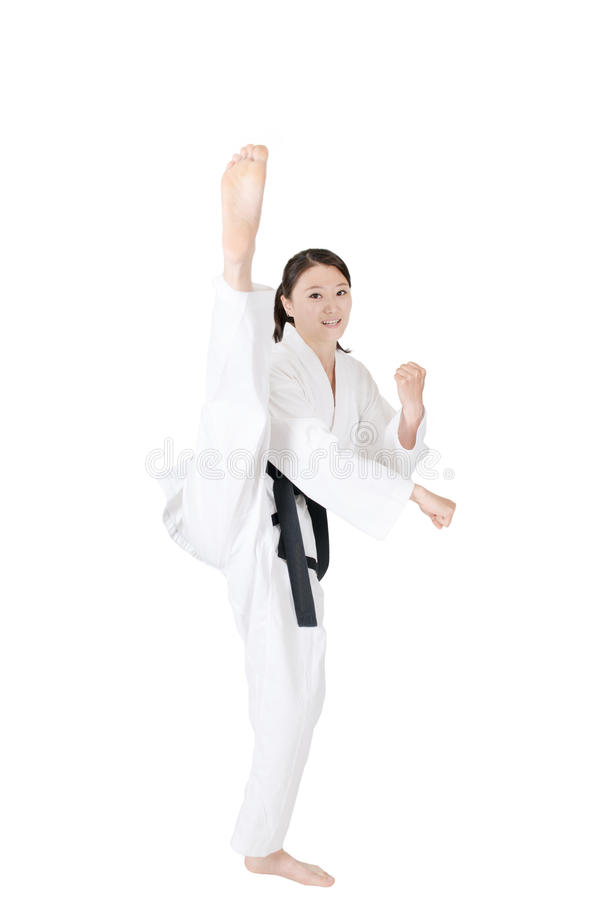 Taekwondo. Woman practicing taekwondo isolated on white background, kicks stock photo