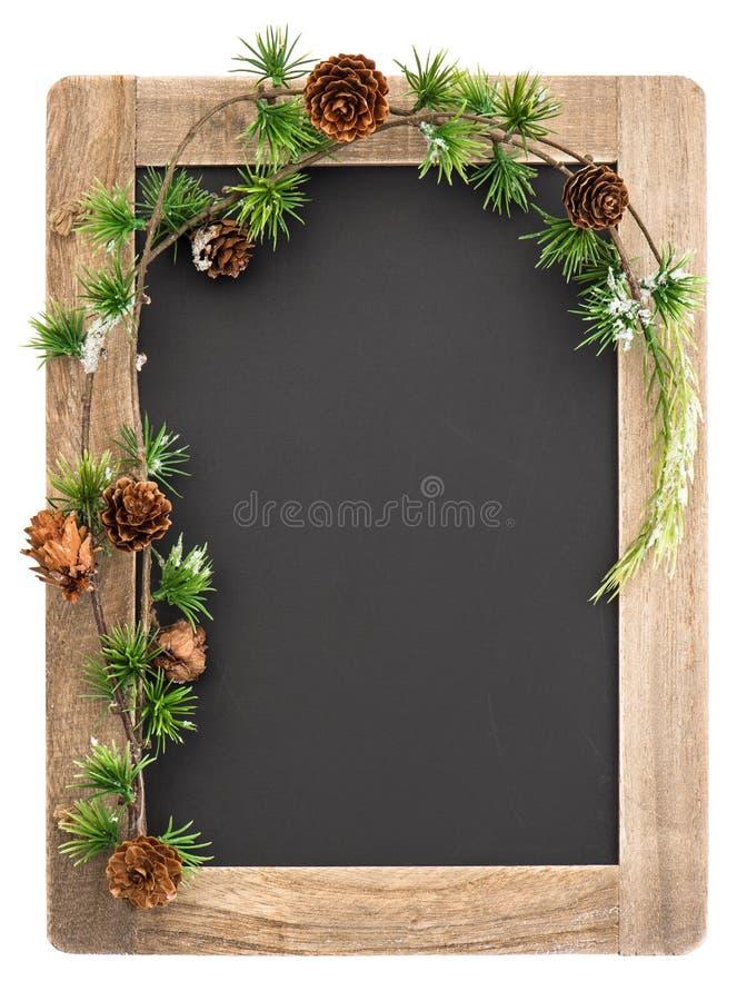 Tafel mit Holzrahmen- und Weihnachtsdekoration stockfotografie
