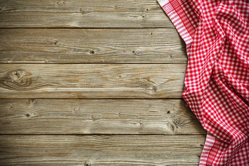 Tafelkleed op houten lijst stock foto
