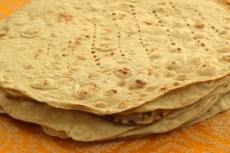 Taftan Bread, Iranian White Bread. A pile of Taftan or Taftoon Bread, a kind of Persian white flatbread royalty free stock image