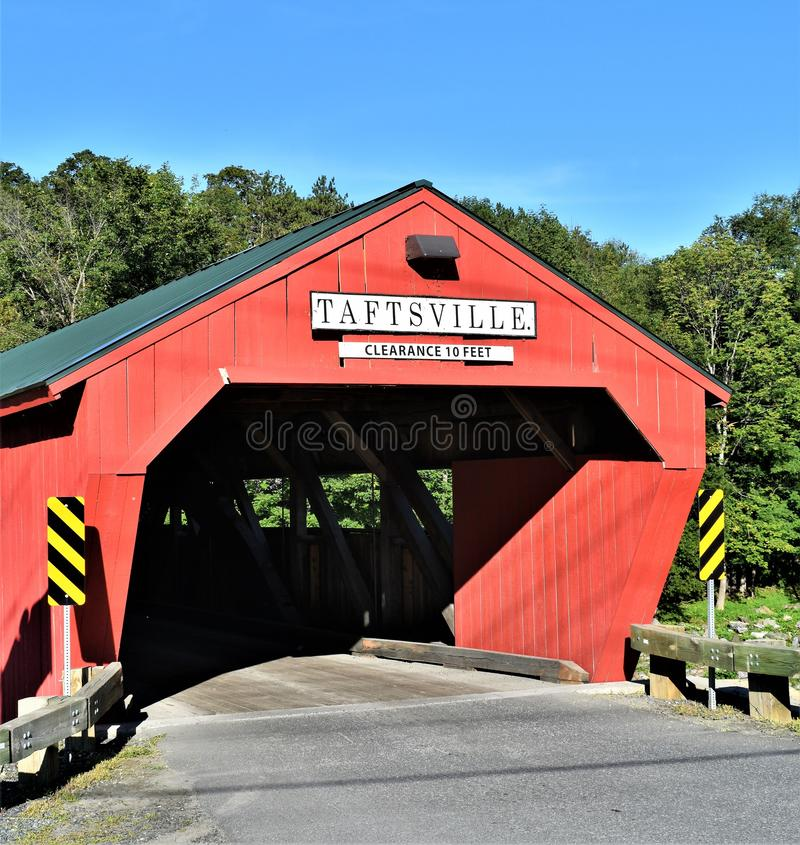 Taftsville Covered Bridge located in the Taftsville Village in the Town of Woodstock, Windsor County, Vermont, United States. Taftsville Red Covered Bridge in stock photography