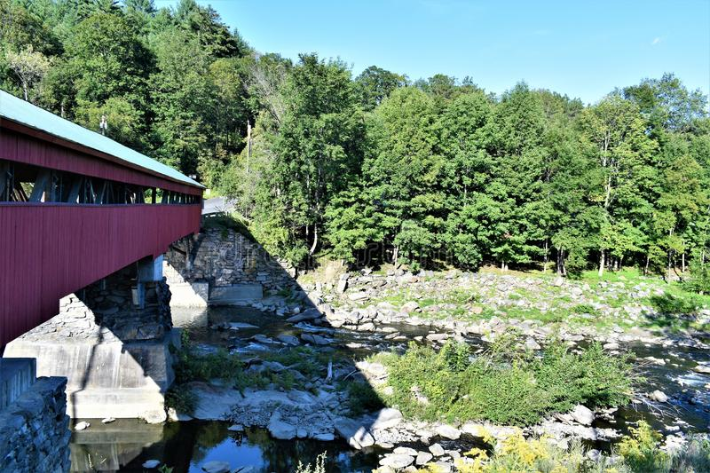 Taftsville Covered Bridge in the Taftsville Village in the Town of Woodstock, Windsor County, Vermont, United States. Side of Taftsville Red Covered Bridge in stock photo