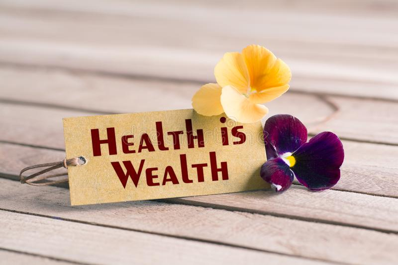health is wealth tag stock photos
