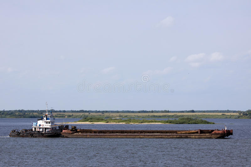 Tag boat. Sailing in a river flow of northern europe stock photography