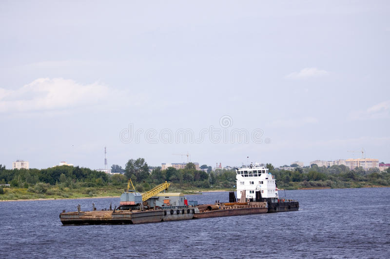 Tag boat. Sailing in a river flow of northern europe stock photo