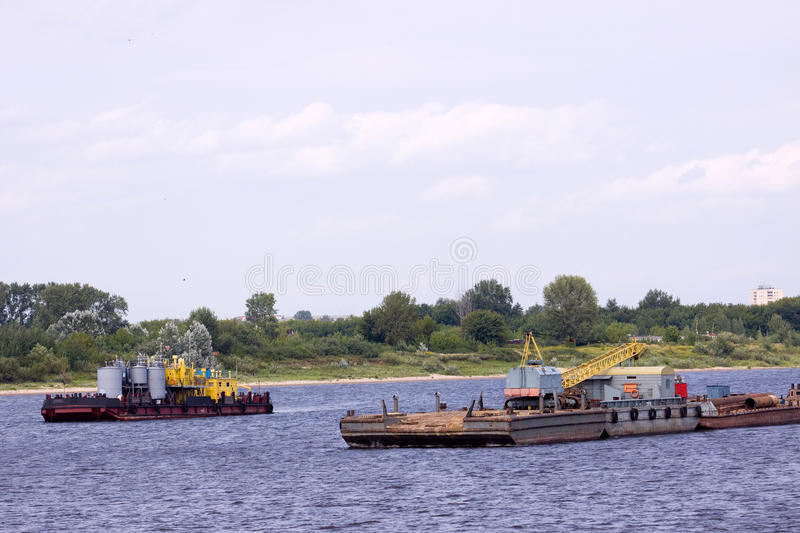 Tag boat. Sailing in a river flow of northern europe royalty free stock photos
