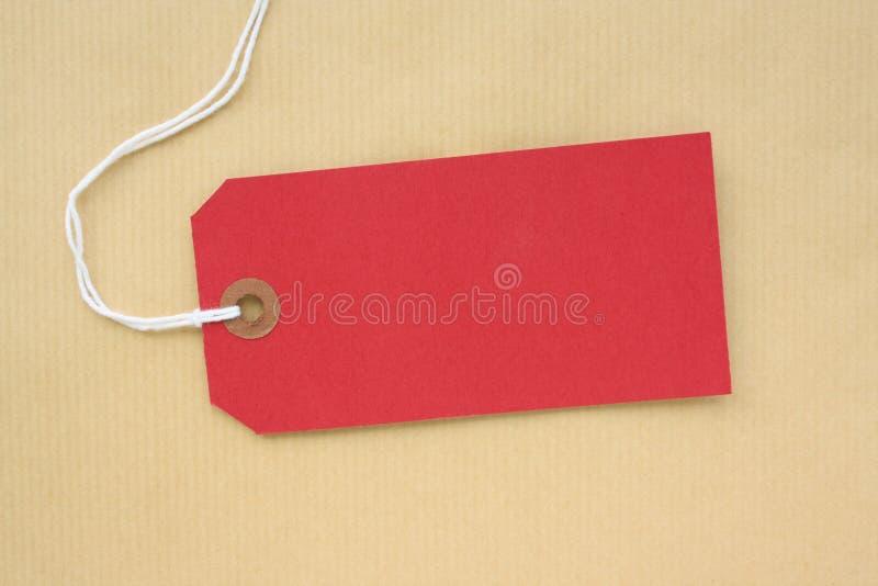 Tag de papel vermelho da bagagem imagem de stock