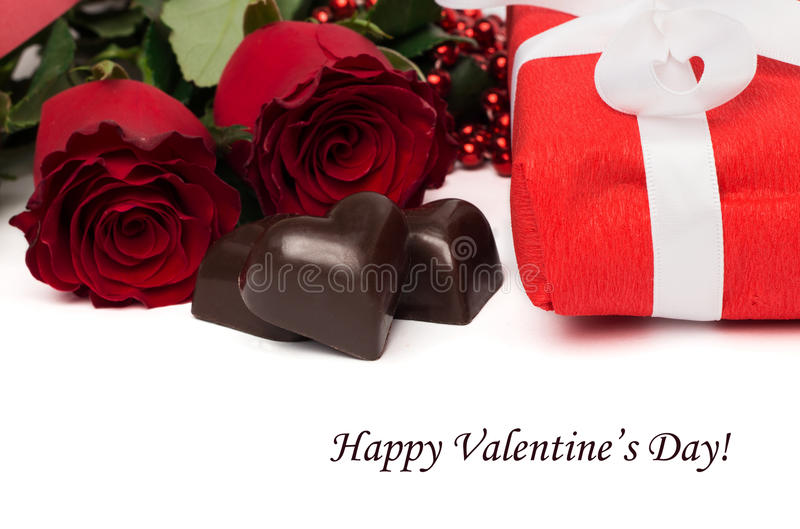 Tag Happy Valentine's Daу with red present box and white ribbon stock photography