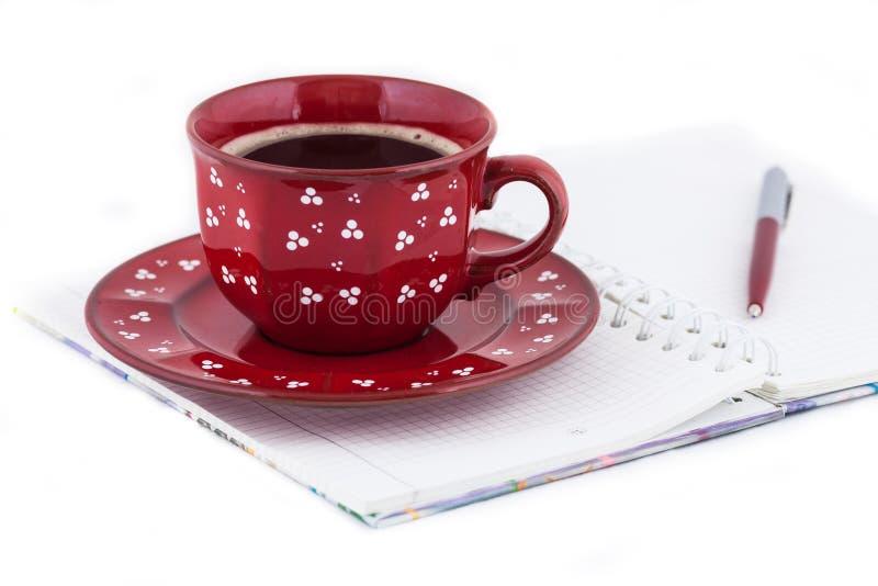 Tagebuch und Kaffee stockbild