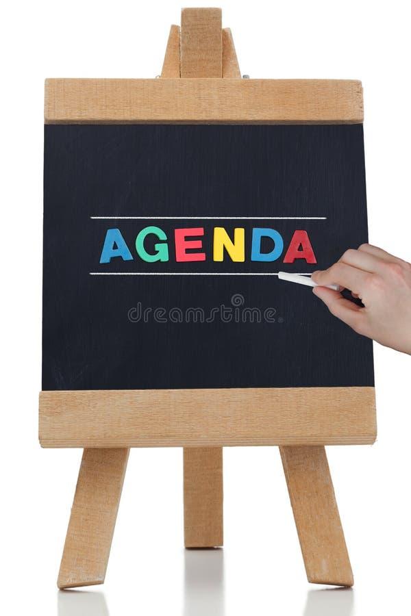 Tagesordnung geschrieben in farbige Buchstaben stockfotos