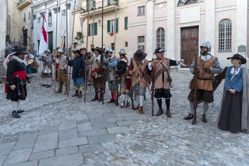 Medieval costume party. Taggia, Italy - March 17, 2018: Participants of medieval costume party in the historic city of Taggia in Liguria region of Italy. The royalty free stock images