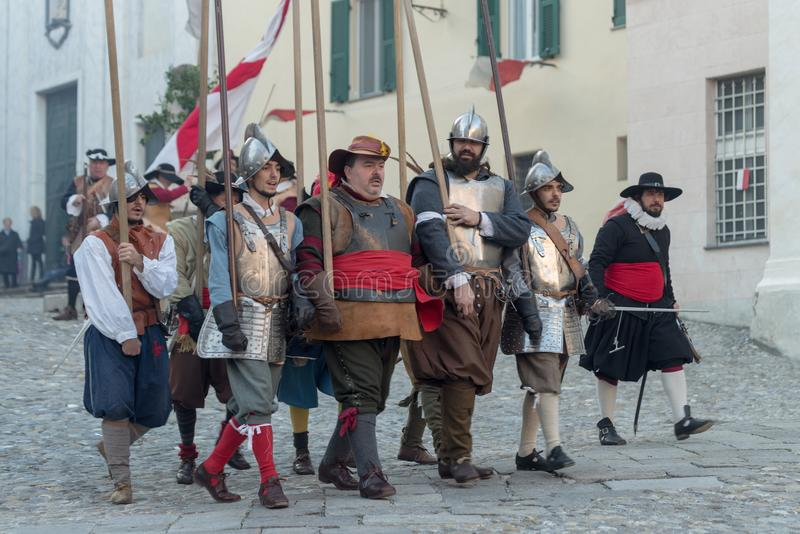 Medieval costume party. Taggia, Italy - March 17, 2018: Participants of medieval costume party in the historic city of Taggia in Liguria region of Italy. The stock photography