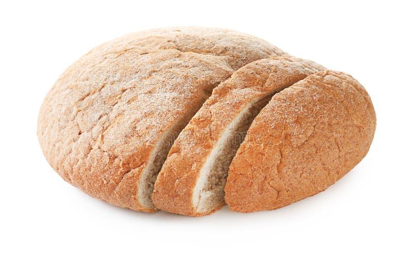 Tagli la pagnotta di pane di recente al forno immagine stock
