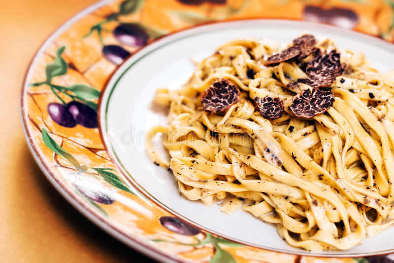 Tagliatelle with black truffle stock images
