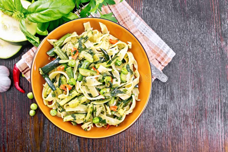 Tagliatelle with green vegetables on board top stock photography
