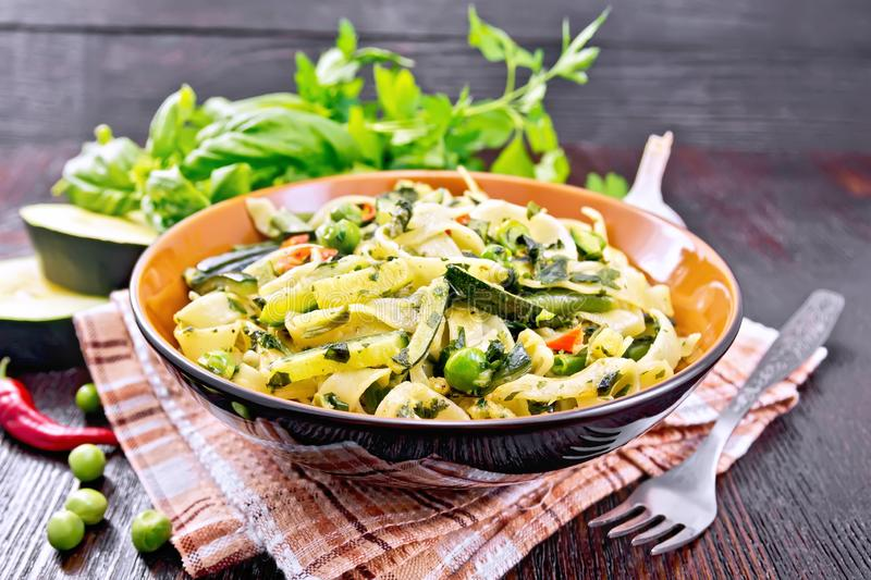Tagliatelle with green vegetables on napkin stock photography