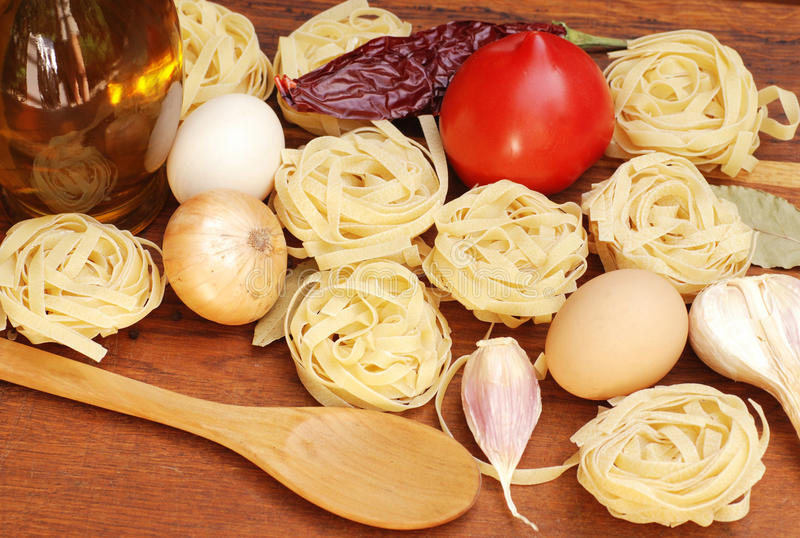 Download Tagliatelle Pasta Ingredients On Wooden Board Royalty Free Stock Images - Image: 25920629