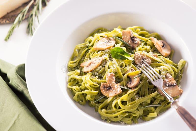 Tagliatelle pasta with pesto royalty free stock photo