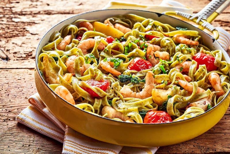 Tagliatelle pasta with shrimp garlic and spinach stock photo