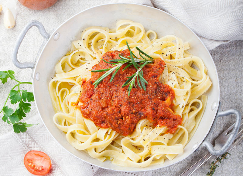 Tagliatelle pasta with tomato sauce and red pesto Top view. Tagliatelle pasta with tomato sauce and red pesto Italian cuisine Top view royalty free stock images