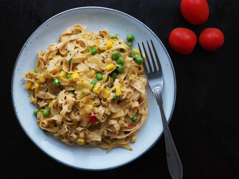 Tagliatelle pasta with vegetarian carbonara royalty free stock image