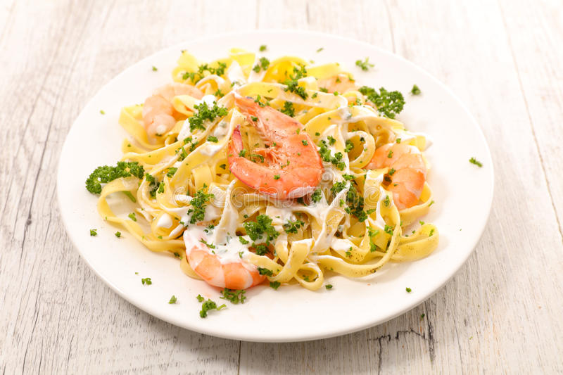Tagliatelle with shrimp royalty free stock images
