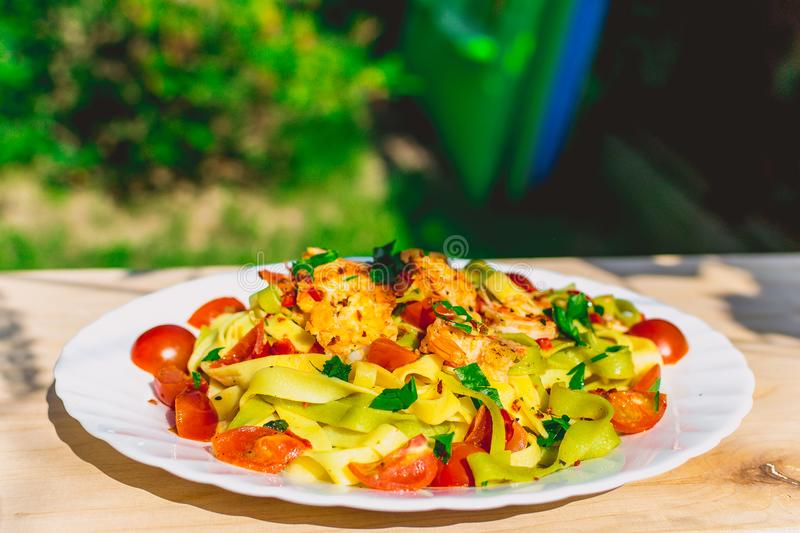 Tagliatelle with shrimps and tomatos royalty free stock images