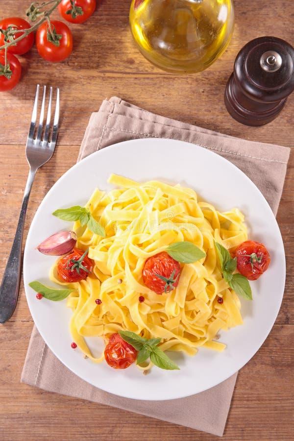Tagliatelle and tomato stock photos