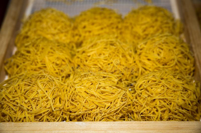 Tagliatelle typical products of Emilia Romagna. Tagliatelle pasta eggs and flour typical products of Emilia Romagna stock photo