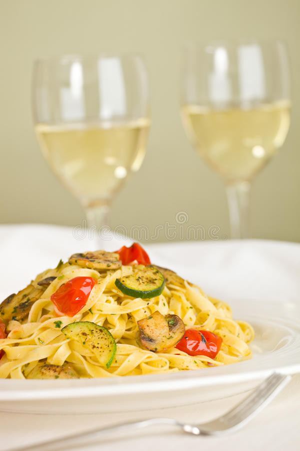 Tagliatelle and white wine royalty free stock photo