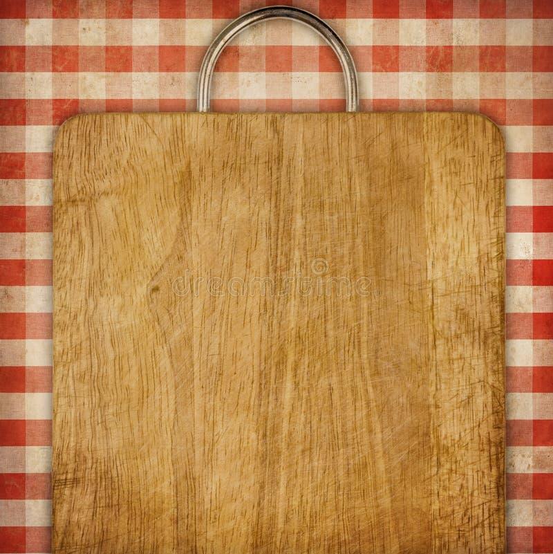 Tagliere del fondo di ricetta sopra il tablecoth rosso di picnic del percalle fotografia stock