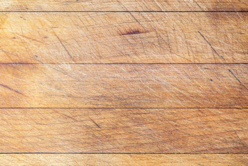 Tagliere di legno con le linee orizzontali fondo immagine stock