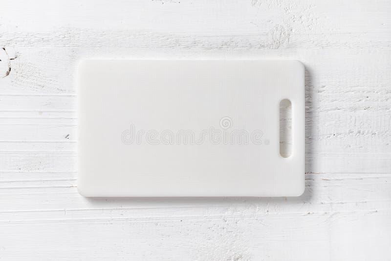 Tagliere di plastica bianco immagine stock